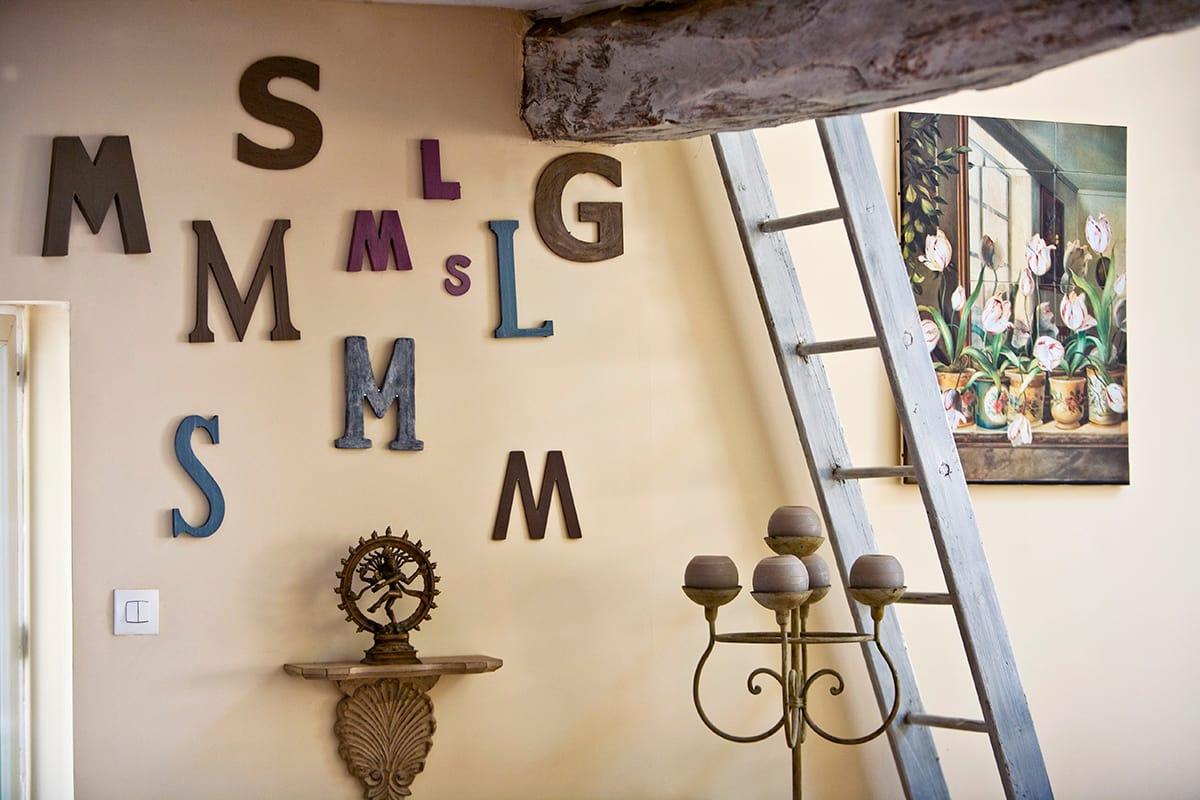 Tendenza lettering come rendere speciali pareti ed angoli for Quadri giganti da parete